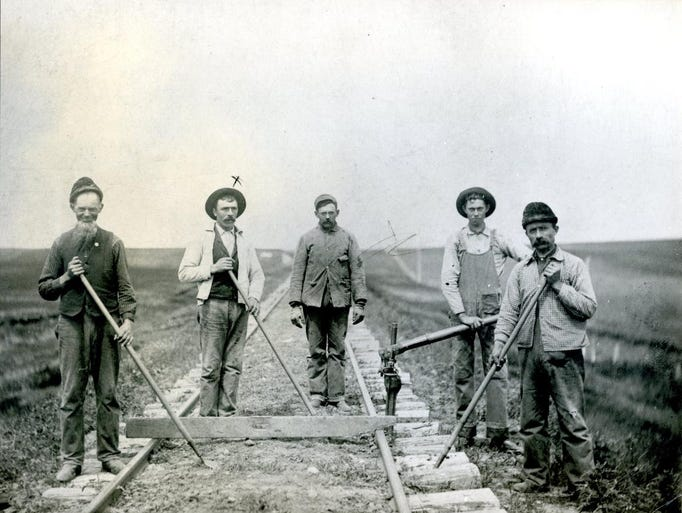 "Dan O'Connor (second from left), grandfather of Monsignor James Doyle, with his crew of ""gandy dancers"" working on the Rock Island Line between Watertown and Sioux Falls."
