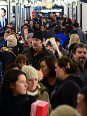 Shoppers fill the aisles at a Macy's department store on Thanksgiving night in New York.  For the first time, most Macy's locations opened  on Thanksgiving Day to accommodate early Black Friday shopping.