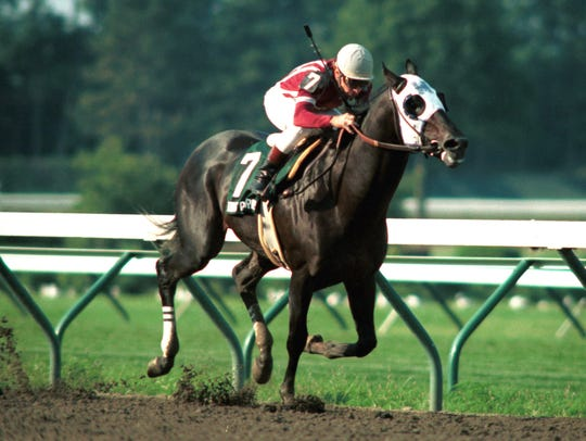 King Glorious, with Chris McCarron riding, wins the