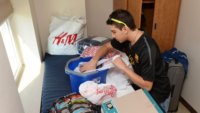 Freshman Gabriel Bazquez comes to the Mount from Puerto Rico, and was aided on move-in day by his mother, Annie, and father, Jos.