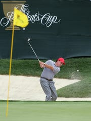 Phil Mickelson plays out of a bunker during the second