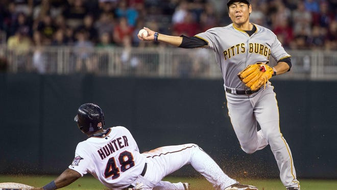 Pittsburgh Pirates shortstop Jung Ho Kang (27) forces out Minnesota Twins right fielder Torii Hunter (48) at second base and throws the ball to first base for a double play in the fifth inning Tuesday at Target Field in Minneapolis.