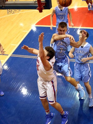 Boone County forward Justin Bowman swats away the shot of Conner guard Aria Alimardani.