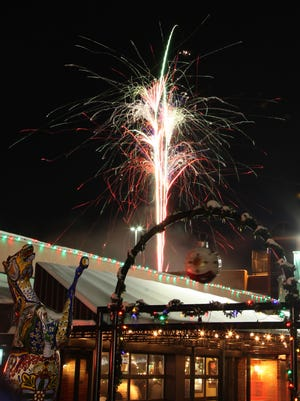 Fireworks burst above Coopersmiths on New Year's Eve 2014 for First Night Fort Collins.