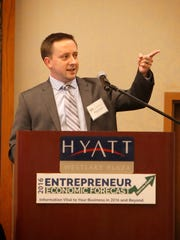 Stephen Basham, of CoStar Market Analytics National Economic and Multifamily Outlook, speaks during Thursday's conference about home ownership and the current state of the housing economy.