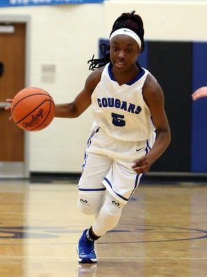 Clark Guard Zion Wright races up the court on a fast break.