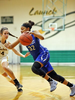 Summit guard Alea Harris drives to the basket in the game between Summit Country Day and McNicholas High School at McNicholas. Summit Country Day defeated McNicholas 56-39.