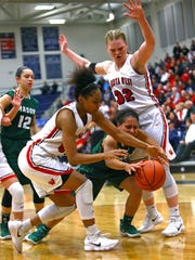 Mason guard Sade Tucker chases a loose ball out of bounds in the OHSAA Regional Final game between the Mason Comets and the Lakota West Firebirds at Fairmont High School in Kettering Ohio. Mason defeated Lakota West 54-51 and will advance to the final four.