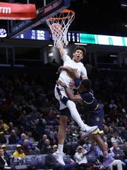 Moeller forward Jaxson Hayes is fouled on his drive to the hoop.