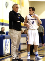 Mariemont Head Coach Jim Leon has some instructions for guard Andrew Hall. Mariemont defeated New Richmond 46-33.