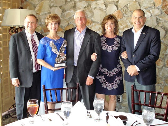 From left to right: Mike Carter, co-owner of Coldwell Banker Legacy, Irma Morris, relocation director for the agency's El Paso branch; Cyndi Carter, agency co-owner; Charles DeWetter, agency broker; and C.B. Starks, managing director of USAA Residential Real Estate Services, which gave the El Paso branch its Real Estate Rewards Network Eagle Award at a May 2 luncheon.