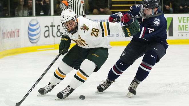 Catatmounts forward Anthony Petruzzelli (28) skates past UConn's Miles Gendron (10) during the men's hockey game between the UConn Huskies and the Vermont Catamounts at Gutterson Fieldhouse on Friday night.