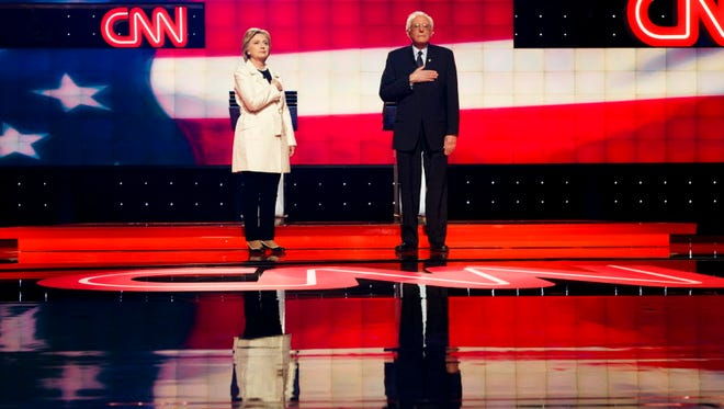 Hillary Clinton Bernie Sanders,appear on stage during the start of a CNN-sponsored debate in Brooklyn in April.