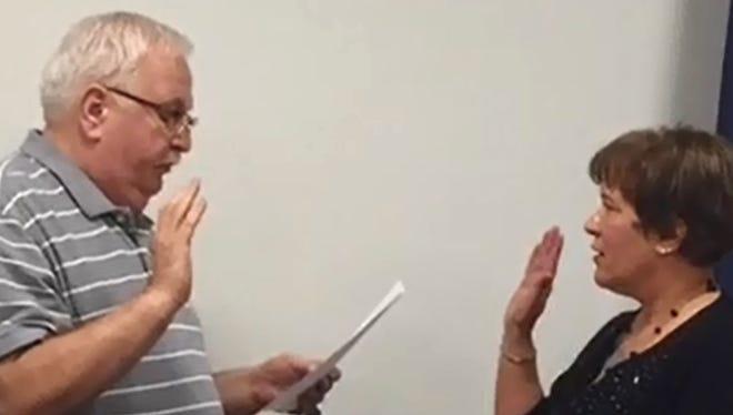 Jane Quairoli is sworn into Palmyra Borough Council by Mayor Fred Carpenter.
