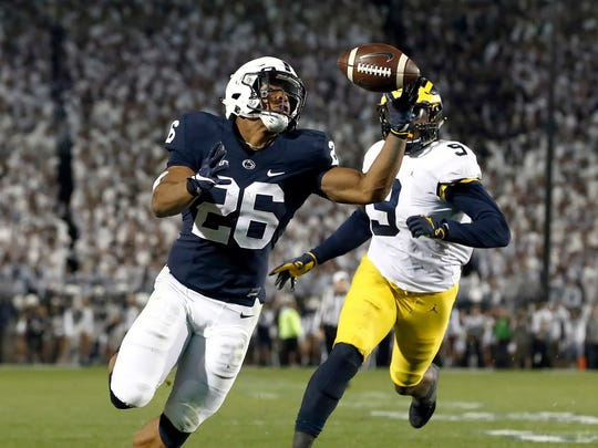 Oct. 21: Penn State's Saquon Barkley gains control of a pass and takes it in for a touchdown against Michigan during the second half of U-M's 42-13 loss. Barkley compiled 161 yards from scrimmage and scored three times.