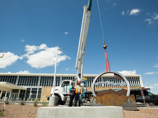 """Karen Yank's art installed """"Pride"""" is installed Tuesday, March 27, 2018 in front of the East Mesa Public Safety Building in Las Cruces. City officials described the 10-foot-by-14-foot sculpture """"asa circle of unity with the police department, fire department and the community."""""""