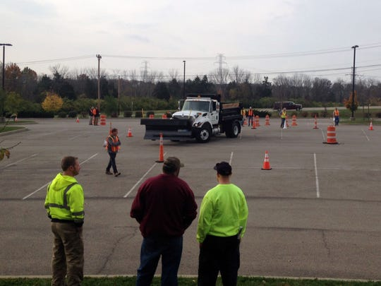 A snowplow driver competes in the Public Works Officials of Southwest Ohio's annual Snowplow Roadeo event at the Mason Sports Park on Tuesday, Oct. 28, 2014.