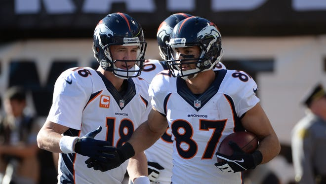 Broncos quarterback Peyton Manning (18) congratulates wide receiver Eric Decker (87) on a touchdown during the first quarter against the Raiders on Dec. 29, 2013.