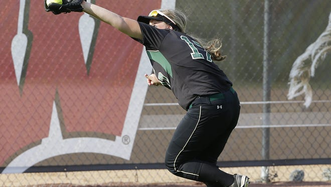 Oshkosh North left fielder Jordyn Dedering makes a running catch of a long fly ball against Union Grove in the Division 1 quarterfinals of the WIAA Girls State Softball tournament in Madison June 9, 2016.