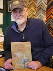 Artist Jim Clary with a print he created to help the