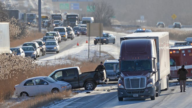Westbound traffic is directed onto the South Webster Avenue ramp in Allouez as authorities work the scene of a multiple-vehicle crash on Wisconsin 172 on Wednesday morning.