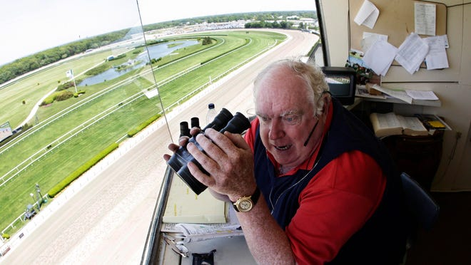 NYRA track announcer Tom Durkin looks down at the Belmont Park homestretch while calling the first race of the day on May 26, 2008, days before Big Brown attempted to win the Triple Crown.