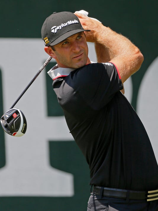 Dustin Johnson watches his tee shot on the first hole during the first round of the PGA Championship golf tournament at Baltusrol Golf Club in Springfield, N.J., Thursday, July 28, 2016. (AP Photo/Tony Gutierrez)