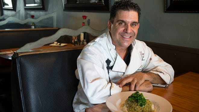 Portrait of John Collura, chef and owner of Cibo e Vino, with his Pistachio crusted Sea Bass, July 8, 2014, in his Scottsdale restaurant, 34522 N. Scottsdale Road. John's passion for Italian cooking started when he was a young boy in Brooklyn cooking Sunday dinners with his great grandmother for 40 family members. As an adult, he opened a couple of successful pizza restaurants. At the age of 40, John sold his businesses and enrolled at Le Cordon Bleu, where he earned his degree. He opened Cibo about three years ago, cooking dishes based on his family recipes.