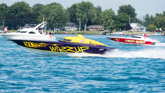 Wazzup passes Strictly Business during the Class 3 race Sunday, July 29, 2018 during the St. Clair River Classic Offshore Powerboat races.