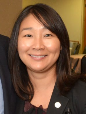 Municipal Court Judge Young Min Burkett has been placed on unpaid leave for 90 days to give her time to obtain U.S. citizenship.