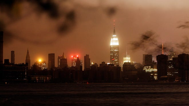 After Superstorm Sandy hit on Oct. 29, 2012, the power went out and New York skyline went dark.