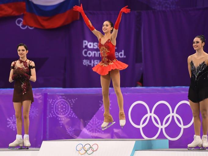 Alina Zagitova (OAR) celebrates after winning the gold