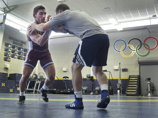 Canton High School alum Alec Pantaleo (left), shown during a 2016 Team USA practice gearing up for the an international tournament, echoes others who consider wrestling to be the toughest grind for any prep athlete.