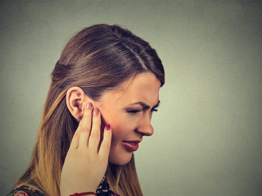 sick young woman having ear pain
