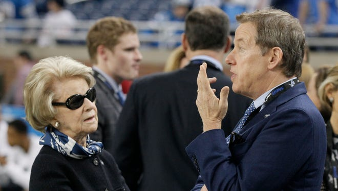 Detroit Lions vice chairman Bill Ford, right, speaks with his mother and Lions owner, Martha Ford, before a game against the Chicago Bears  on Nov. 27, 2014.