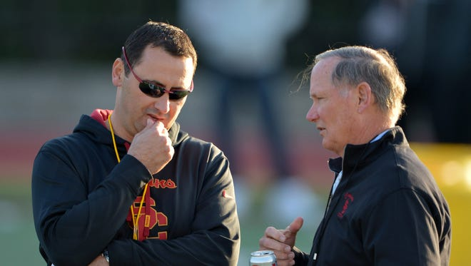 Ex-USC coach Steve Sarkisian (left) and athletic director Pat Haden at spring practice at Cromwell Field.