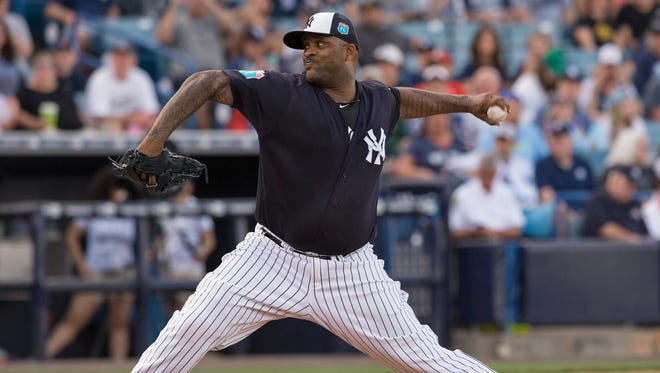 New York Yankees starter CC Sabathia pitches against the Tampa Bay Rays during the first inning of a spring training baseball game Thursday, March 24, 2016, in Tampa, Fla.