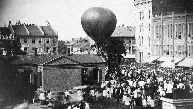 """The first official American airmail delivery took place with the launch of the gas airmail balloon, """"Jupiter,"""" from Fourth and Wall Streets in Lafayette on Aug. 17, 1859. The Lafayette postmaster had 120 cards and letters on board. However, a north wind landed the balloon in a Crawfordsville field, so the cargo had to travel by train the rest of the way to New York."""