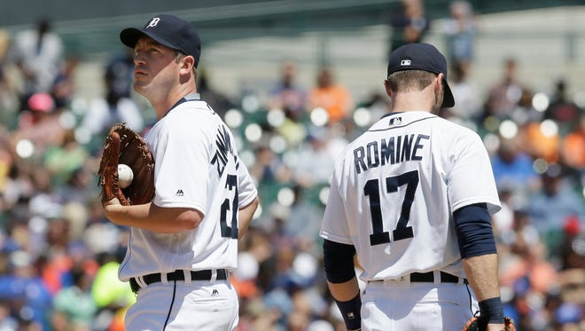 Detroit Tigers starting pitcher Jordan Zimmermann, left, stands on the mound with first baseman Andrew Romine after giving up a two-run triple to Toronto Blue Jays' Kevin Pillar during the fifth inning of a baseball game, Wednesday, June 8, 2016, in Detroit.
