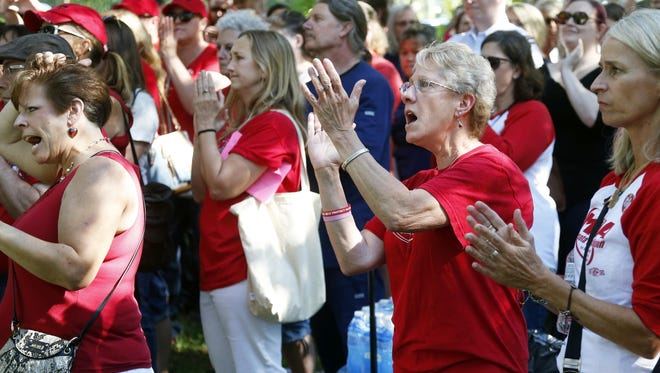 Members of the Minnesota Nurses Association applaud during a rally as community, labor leaders and faith-based groups gather at Stewart Park, Wednesday, Aug. 31, 2016 in Minneapolis to show support for Allina Health nurses who are scheduled to go on strike Monday, Sept. 5, unless a settlement is reached.