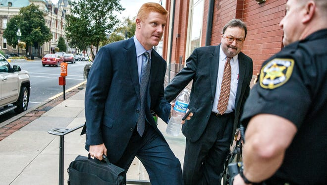 Former Penn State football assistant coach Mike McQueary arrives Thursday at Centre County court.