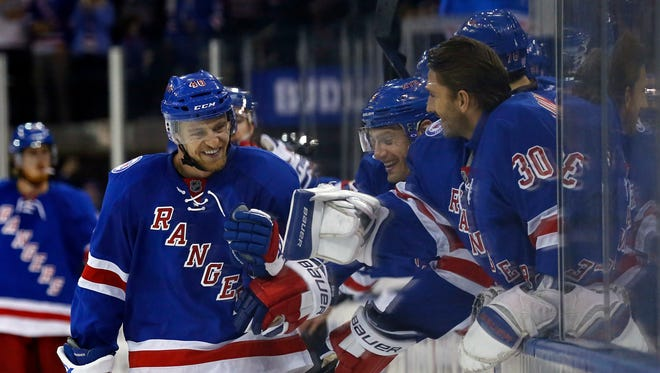 New York Rangers right wing Michael Grabner (40) celebrates with teammates after scoring his third goal of the game during the third period against the Tampa Bay Lightning at Madison Square Garden on Sunday, Oct. 30, 2016.