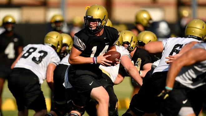 Vanderbilt quarterback Kyle Shurmur runs drills during the first football practice of preseason camp at Vanderbilt University in Nashville, Tenn., Monday, July 31, 2017.