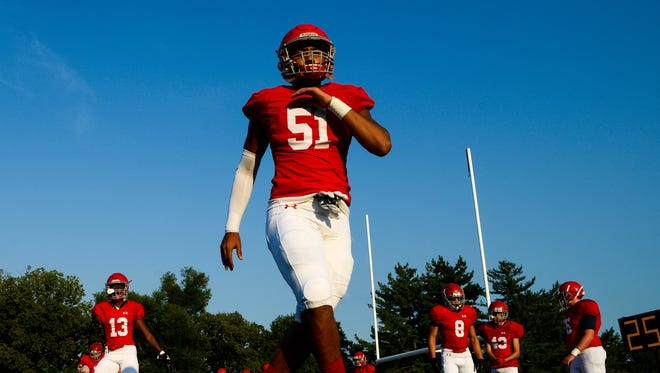 Brentwood Academy's Yirayah LaNier (51) warms up before a game against Hillsboro on Friday.