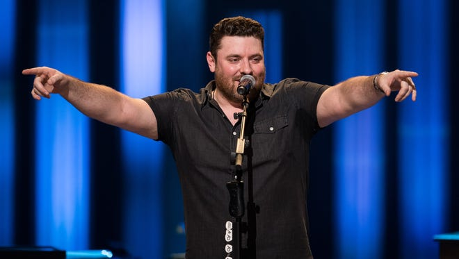 Chris Young reacts after he was invited to join the Opry by Vince Gill at the Grand Ole Opry House in Nashville on Aug. 29, 2017.