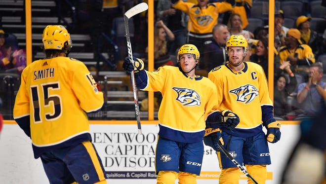 Predators forward Kevin Fiala (center) reacts to scoring against the Columbus Blue Jackets during the third period of a preseason game at Bridgestone Arena on Thursday, Sept. 28, 2017.