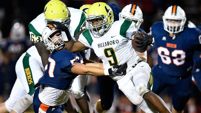 Hillsboro's Jacob Frazier (9) is taken down by Beech's Delaney Williams (57) during the first half at Beech High School in Hendersonville, Tenn., Friday, Sept. 29, 2017.