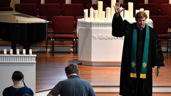 Dr. Clay Stauffer, Senior Minister, closes a service at Woodmont Christian Church in Nashville, Tenn., Wednesday, Oct. 4, 2017. The prayer and healing service was in response to the mass shooting in Las Vegas.
