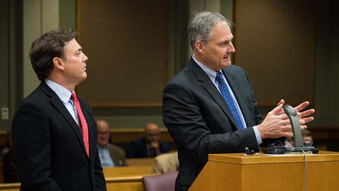 Justin Gilbert, right, attorney for the Does, speaks next to Tony Swafford, left, attorney for Brentwood Academy, during a hearing related to the Brentwood Academy case at the Williamson County Courthouse in Franklin, Tenn., Friday, Dec. 15, 2017.