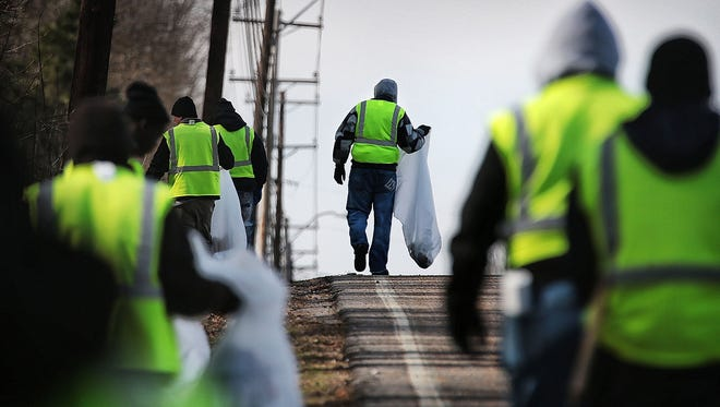 Walter Long (center) and a crew of fellow Work Local recruits clean up along Mitchell Road in the Westwood area Tuesday morning. Work Local which pays homeless people to clean up blight Downtown is expanding its hours, days of service and focus area with funding from the Downtown Memphis Commission and the Memphis Convention & Visitors Bureau.